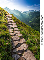 Footpath in the Tatras Mountains at sunrise