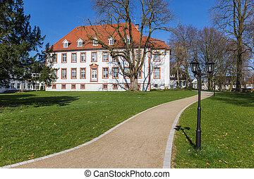 Footpath leading to the Amt Reckenburg building in Wiedenbruck, Germnay