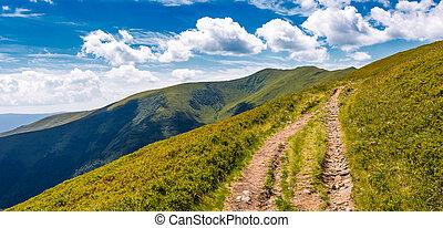 footpath through grassy mountain ridge - footpath through...