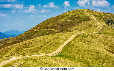 footpath through the grassy hills of mountains. beautiful...