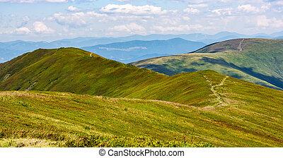 footpath through the mountain ridge - mountain landscape in...
