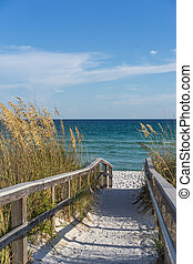 Footpath to beach in paradise - Sandy boardwalk path to a ...