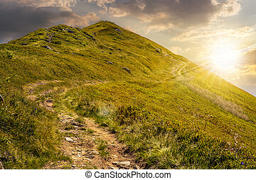 footpath to the mountain top at sunset