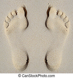 Footprint in sand on beach