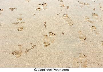 Footprint on sand at the beach