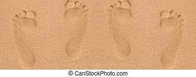 Footprints in sand at the Beach