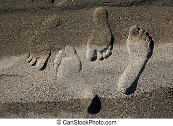 Footprints in the Sand - A pair of lover's footprints marks ...