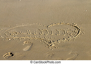 footprints in the sand on the beach during the day