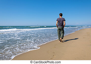 man walking on the beach - footprints of a man walking on...