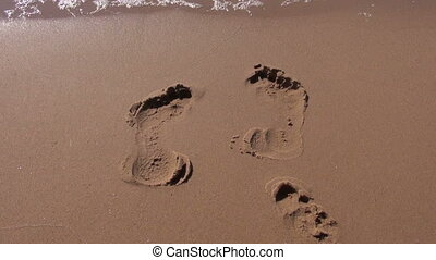 footprints on resort beach sand