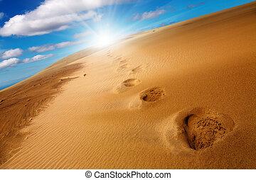 Footprints on sand dune - Desert concept, footprints on sand...