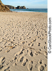 Footprints on the beach at Porthcurno, Cornwall.