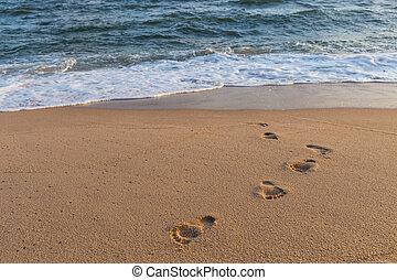 Footprints on the sand beach