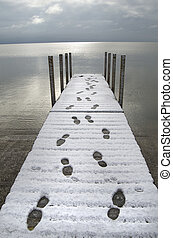 Footsteps on Snowy Dock