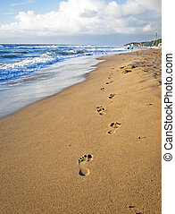 Footsteps on the Beach in Italy