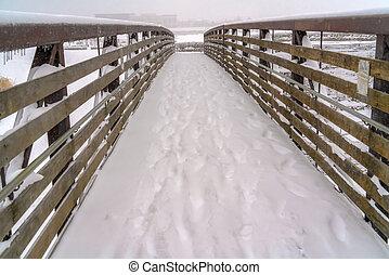 Footsteps on the snow covering a bridge in Utah