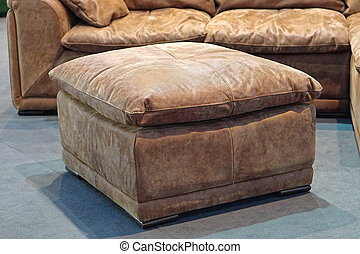 Big leather footstool in living room