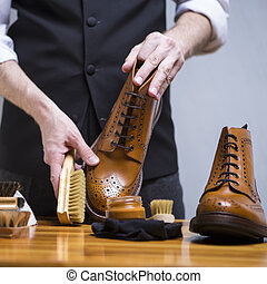Footwear Concepts. Closeup of Mans Hands Cleaning Luxury...