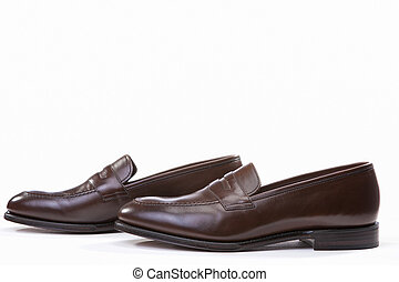 Footwear Concepts. Closeup of Pair of Stylish Brown Penny Loafer Shoes Against White Background.