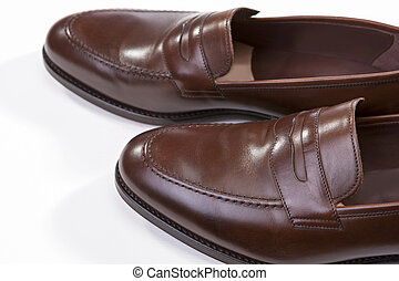 Footwear Concepts. Closeup of Pair of Stylish Brown Penny Loafer Shoes Against White Background. Above View.