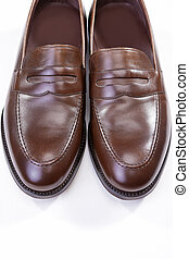 Footwear Concepts. Pair of Stylish Brown Penny Loafer Shoes Against White Background. Placed Together Closely