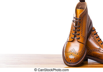 Footwear Concepts.Closeup of Pair of High Gentleman Tanned...