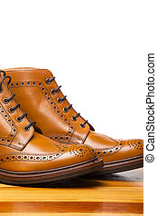 Footwear Concepts.Closeup of Pair of High Men's Tanned...