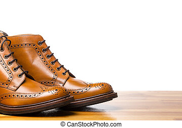 Footwear Concepts.Closeup of Tips of Pair of Tanned Brogues...