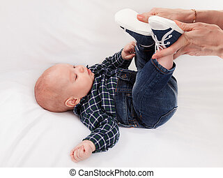 Footwear for the baby - Baby dressed in gym shoes and jeans