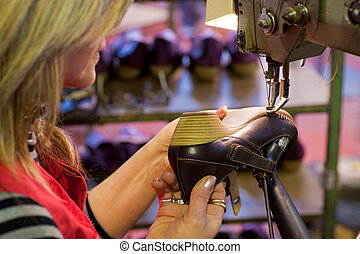 Footwear manufacture - Experienced worker sewing leather ...