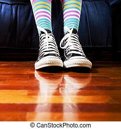 footwear - girl in a waiting room. Close up of her footwear