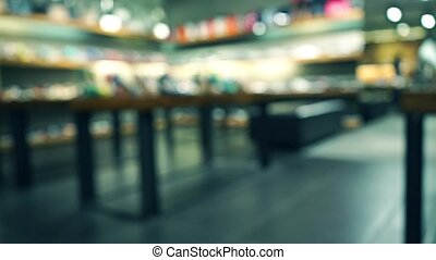 Footwear store bokeh blurred pan video - Footwear store...