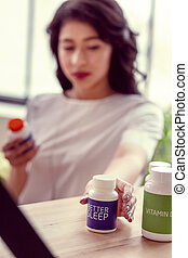 Selective focus of a bottle with sleeping pills