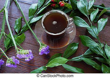 For Breakfast coffee and flowers on wooden background