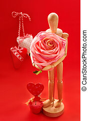 for my valentine - wooden model holding big pink rose as...