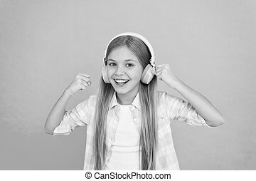 For pleasant musical exposure. Little girl child listening to music. Happy little child enjoy music playing in headphones. Adorable music fan. Music makes her happy