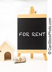 For Rent wordings on a chalkboard