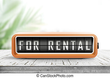 For rental text on an analog device in orange color