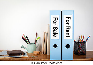 For sale and rent binders in the office. Stationery on a wooden shelf