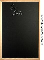 for sale is written on a blackboard