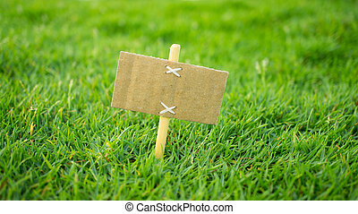 For Sale Sign - A miniature for sale sign on green grass