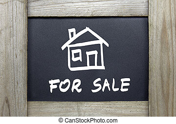 for sale sign on blackboard