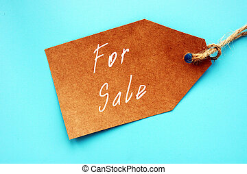 For Sale sign on the sheet.