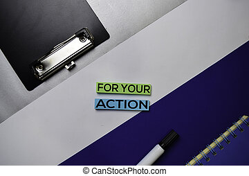 For Your Action (FYA) text on sticky notes with color office desk concept