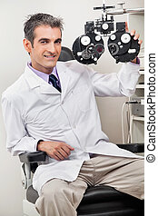 For Your Eye Checkup - Portrait of male optometrist smiling...