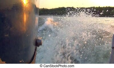 forage cutter with mounted engine, on the won the Wake at sunset