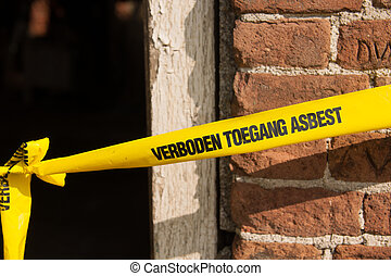 Forbidden asbestos - Yellow ribbon with Dutch text forbidden...