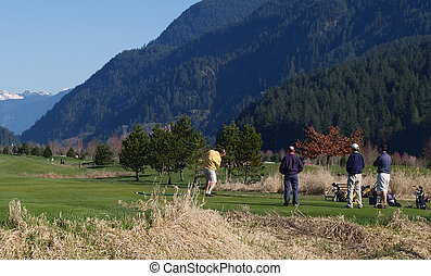 Golfers at the tee at local golf course