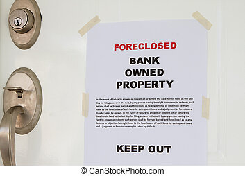 Foreclosed notice on a main door of a house.