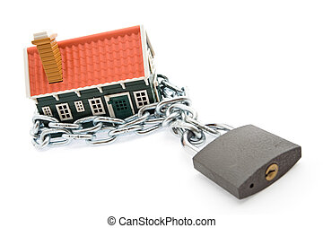 Foreclosure and mortgage concept - House in chains locked...